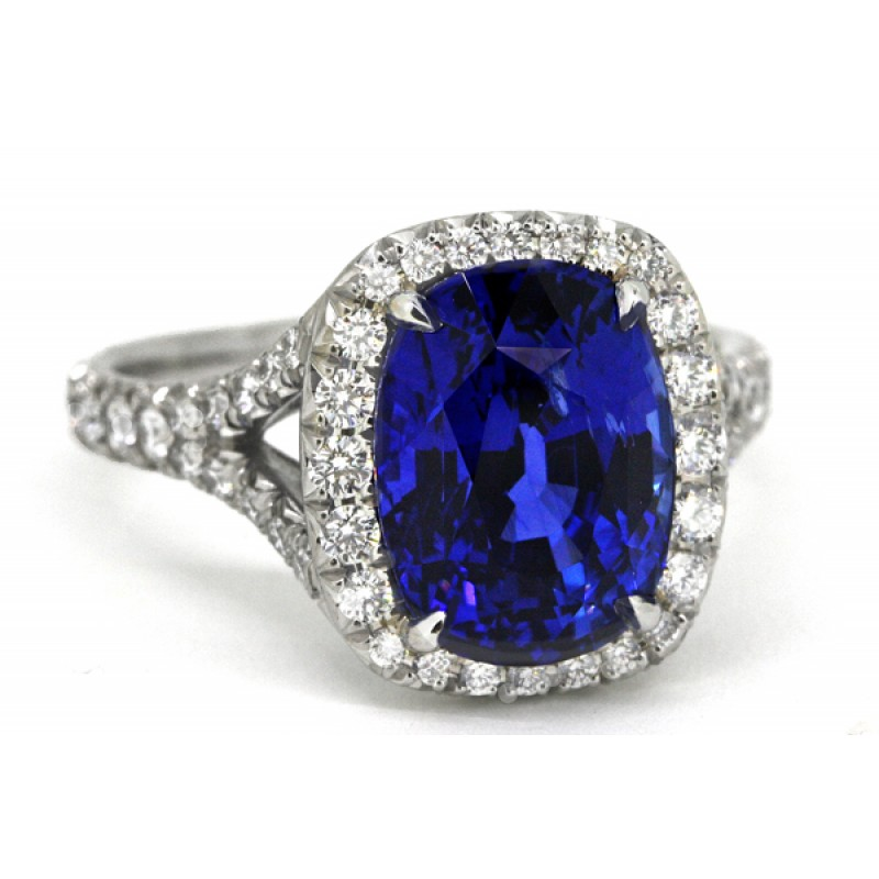 Blue sapphire cushion pave' diamond halo ring