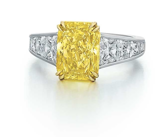 Radiant cut Fancy Yellow Diamond ring