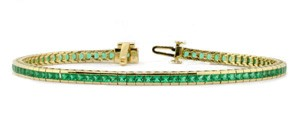 Yellow gold channel set emerald bracelet