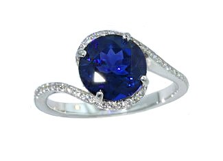 Round blue sapphire bypass style pave' ring