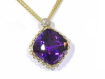 17.81 carat custom cut amethyst 18k gold pendant