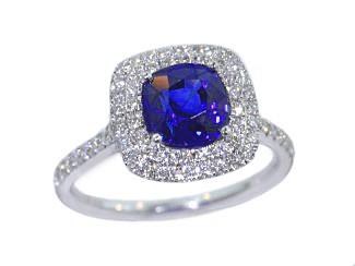 Cushion blue sapphire double pave' diamond halo ring