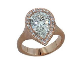 3.12ct Pear diamond in rose gold pave' halo ring