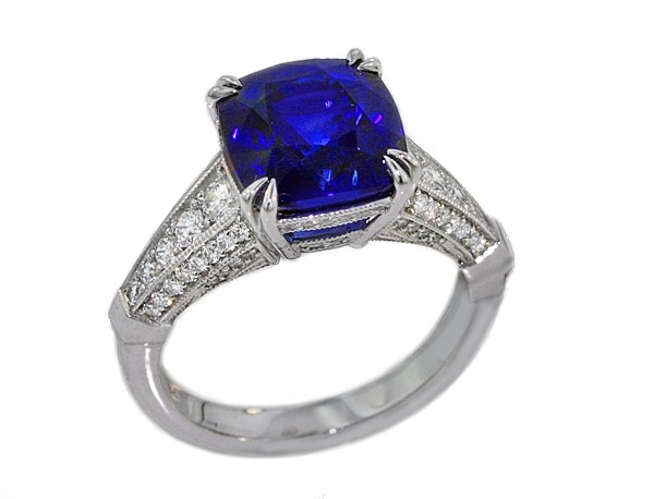 Custom made antique style platinum ring with 5.47ct vivid blue sapphire