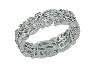 Custom made floral style band with pave diamonds in white gold