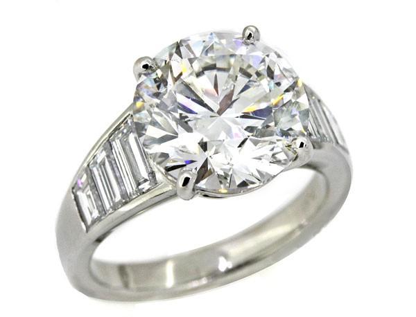 Custom cut channel set trapezoid diamond engagement ring